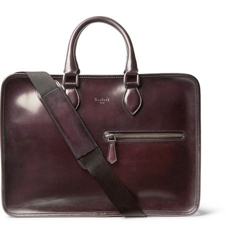 Masterfully polished to achieve a rich merlot patina that will deepen over time, this Berluti 'Deux Jours' briefcase has been crafted in Italy from Venezia leather with a capacious dual-compartment interior and handy pockets to organise your essentials. Use the detachable shoulder strap for easy manoeuvring between meetings or at busy terminals.