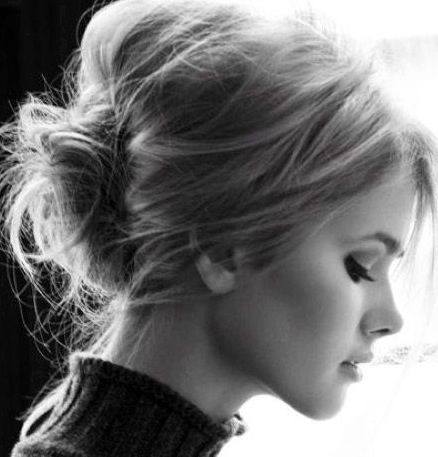 low, messy bun - can do this with med short hair