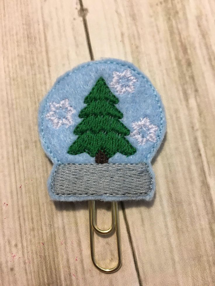 A personal favorite from my Etsy shop https://www.etsy.com/ca/listing/548582979/snow-globe-feltie-clip