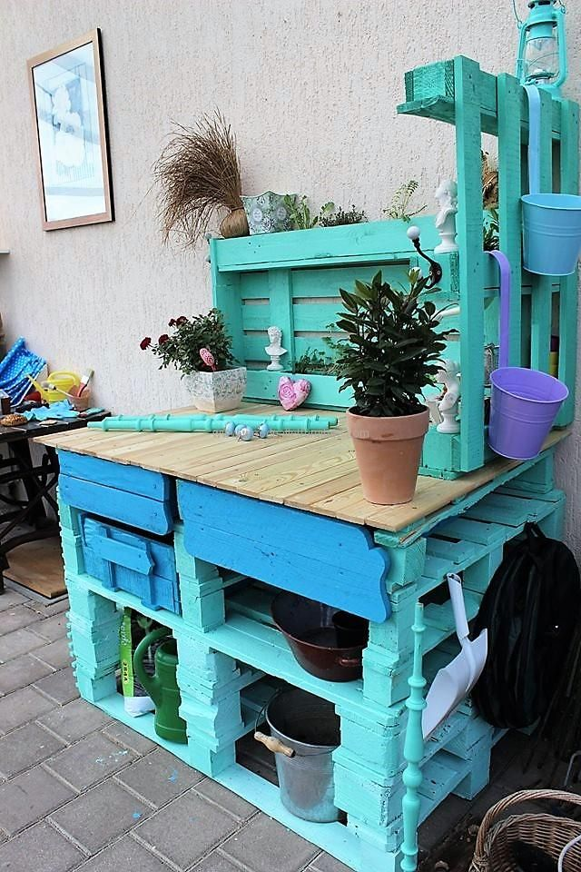 Hooks can be attached to the potting bench for hanging the items with the handle like the plant shower as shown and nails can also be pinned to the pallet for hanging the items that are used in potting. An individual can add as many shelves in the reclaimed potting bench  as he/she wants.