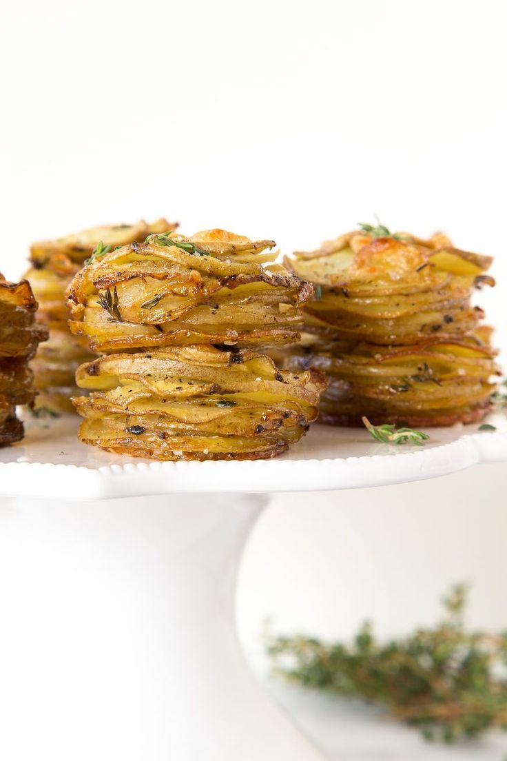 Parmesan Potato Stacks, a simple side dish made of layered yukon gold potatoes with a bit of parmesan cheese and fresh thyme leaves.