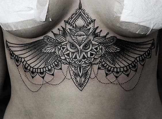 Sternum tattoos are the most kick ass tattoos a woman could get. Look at this painstakingly awesome owl sternum tattoo.