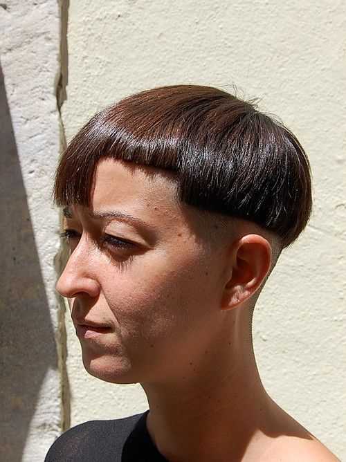 Assymetric Bob Haircut  I'm sorry....but WTF? This is one of the ugliest things I've ever seen done to a woman. Holy crap. I will never understand.