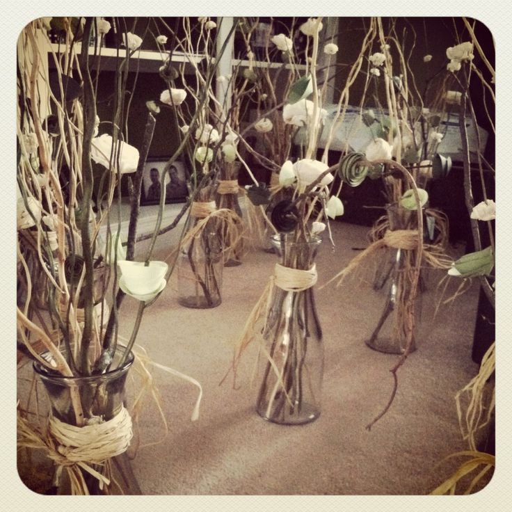 twigs and paper flower centerpieces- very inexpensive and rustic chic!