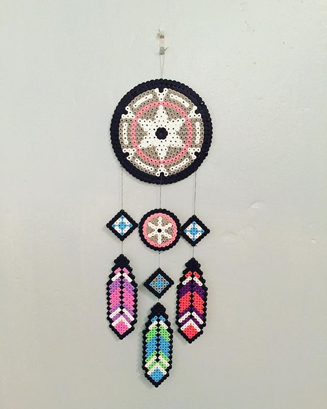 Brought all my old Hama beads over for Caleb and got bored... #dreamcatcher #hamabead #perlerbeads #feather #colourful #creative #crafting #childhood