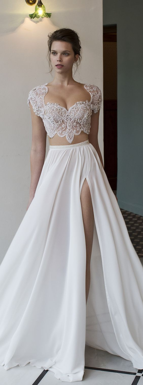 Stunning two piece embellished bodice wedding dress with thigh high slit; Featured Dress: Riki Dalal