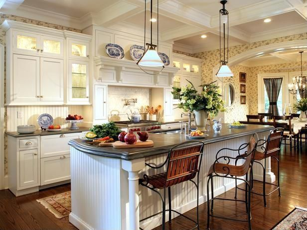 Love the way island is rounded on the side. Love hood over stove and lights over cabinets. Bead board as back splash