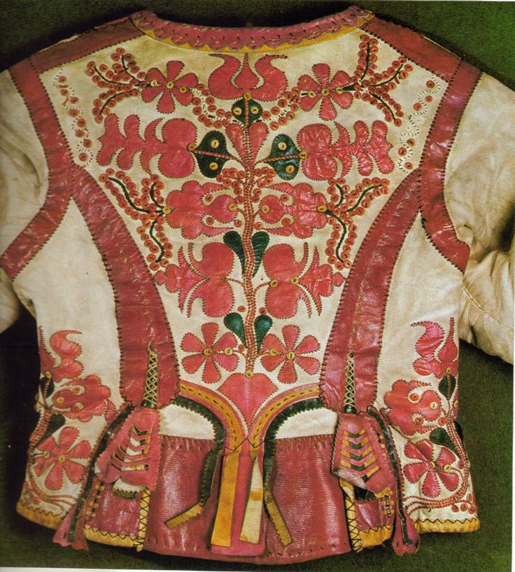 Hungarian embroidery and leather applicationon on a woman' leather jacket, called ködmön. Embroidery is the newer fashioned way of decoration than leather application.
