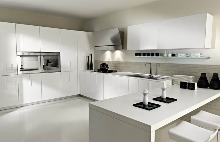 Interesting White Kitchen Design With White Cabinets And Wall Storage And Simple Wall Shelf Also White Dining Table And Chairs And Brown Backsplash Tile And Sleek White Floor Tile And Black Kitchen Appliances