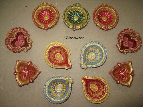 Diyas painted and decorated by me for diwali