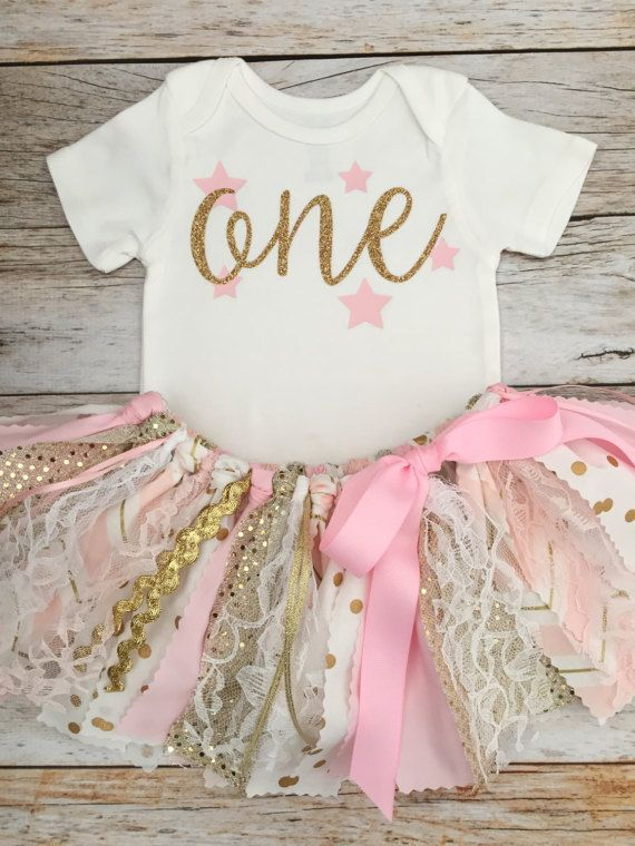 Pink and Gold Twinkle Twinkle Little Star Birthday Outfit LS = long sleeve SS = short sleeve 1. Fabric Tutu/Skirt 2. Bodysuit with Age *In the event that a fabric is temporarily unavailable, a substitute fabric of the same color will be used. *Bodysuit design and glitter color can
