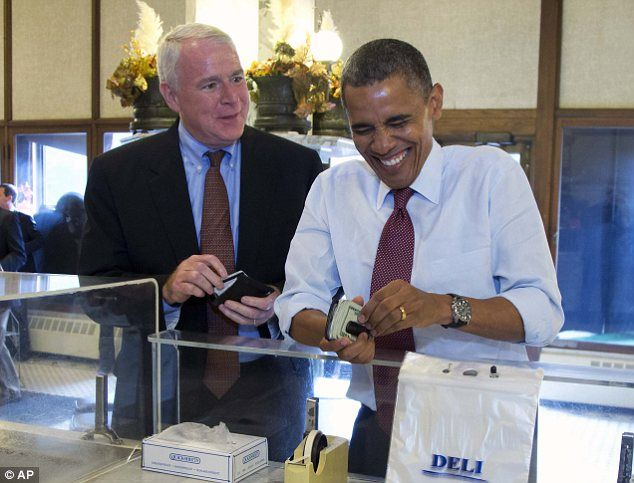 Is that where the deficit's hiding? Obama whips out massive wad of cash to pay for sausages