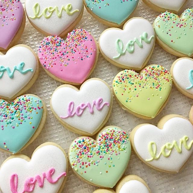 Love & Heart Themed Cookies by @bluesugarcookieco decorated. with pastel colors frosting. Add phrases from those sugar heart shaped Valentines from our childhood. LBE MINE