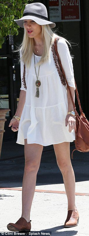 Sixties meets Seventies style: The 40-year-old wore a flimsy white babydoll dress with a m...