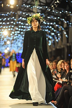 This was a sensation on the catwalk an amazing floor length coat with stunning peacock feathers hand embroidered like a peacock feather tail up the back of the coat.