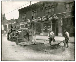 Workers resurfacing Tucker near Market. 1927.
