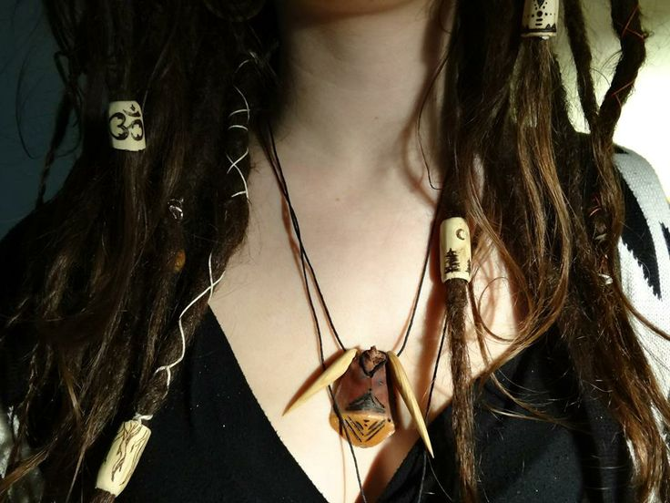 Dread beads can also go on necklaces if you want custom beads. Middle pendant is from an old growth pine cone and has two small spikes on each side