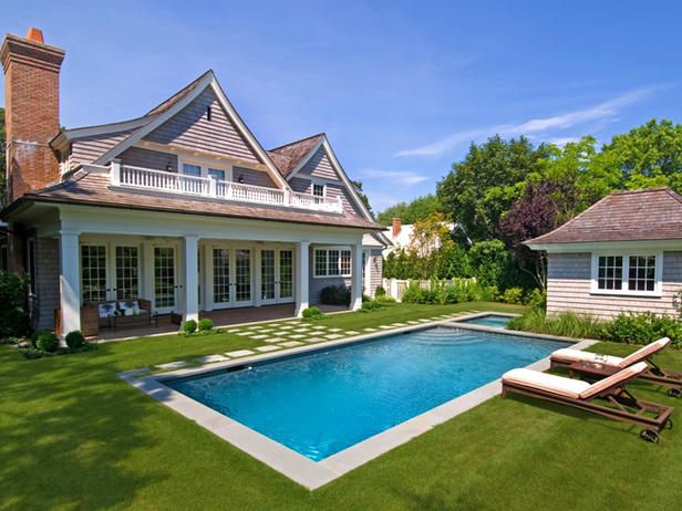 Green Surround This green backyard houses a full-size pool with enough room for swimming laps. - Outdoor Designer Lap Pools on HGTV