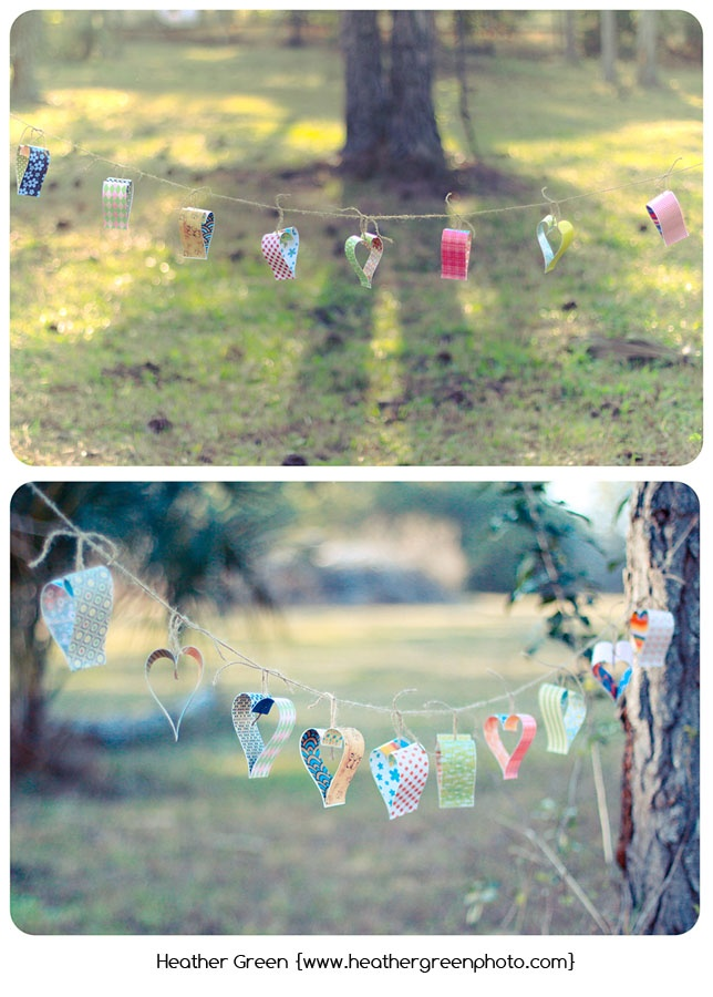 colorful paper cut and folded into hearts, stapled onto looped twine, then tied onto a twine string...so country chic