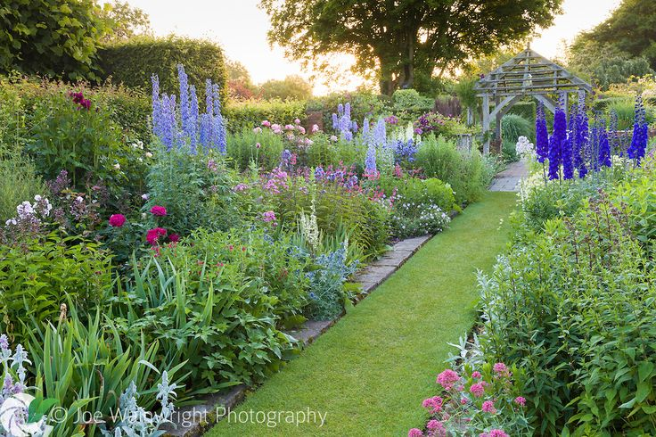 Shortly after dawn in the Sundial Garden at Wollerton Old Hall Garden…