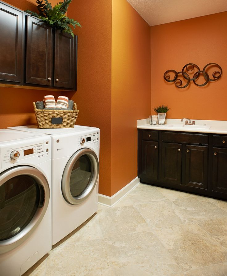 Lighting + storage + convenient sink + workspace = a laundry room to love [Dillon floor plan, Orange Park, FL]