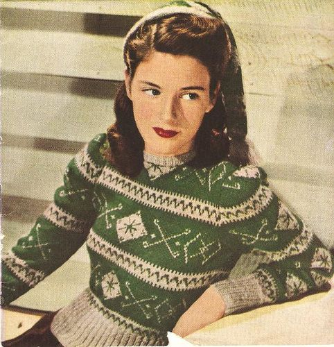 Sweaters became very popular during the 1940s. They were worn by both men and women. They could be worn instead of a waist coat ~ sportswear casual green white ski