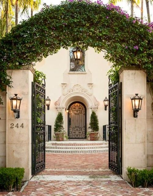 We like this entryway courtyard leading to the steps...we would add a fountain.