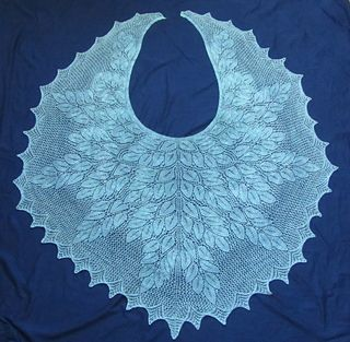 FREE PATTERN This is an almost circular crescent shawl that is knit for the top down.