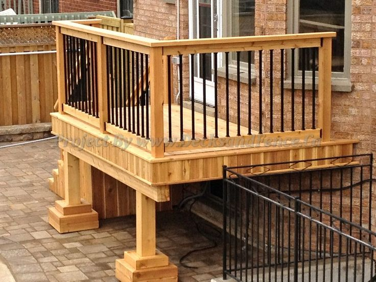 Small Deck Design With Decorative Rails And Well Crafted