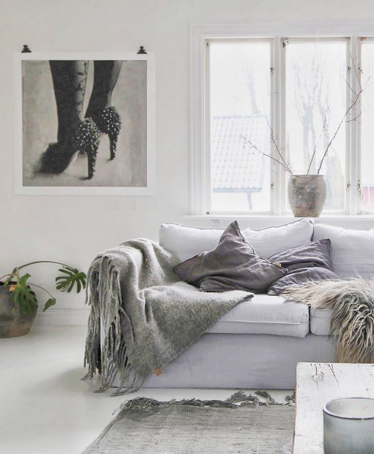 layered minimal nordic boho vibes | Atelje18 gave her IKEA Karlstad sofa a Scandi update with a Bemz loose fit cover in Silver grey Rosendal linen | minimal white and grey scandinavian interior