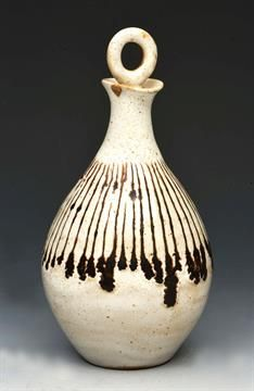 Lot 22 - Lucie Rie (Austrian, 1902-1995) Oil jar and stopper, dripped glaze on white ground impressed