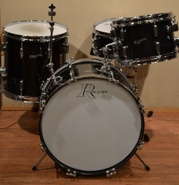 """From Steve Maxwell Vintage Drums: A gorgeous Rogers drum set in rare sizes. This is a 12x20"""" kick, 8x12"""" tom, 14x14"""" floor tom and 5x14"""" Powertone snare drum in black nitron. The kit dates to the early 1960s and has bread-and-butter lugs, which are in great condition. The interiors are super clean and the chrome and wrap are in great shape as well. The drums are remarkably warm and have plenty of punch. The original telescoping cymbal arm is present, as well as some original heads."""