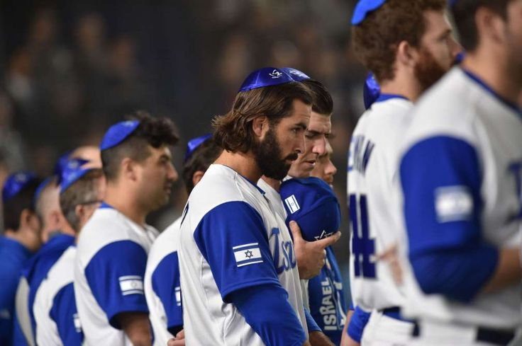 March 13: Israel pitcher Joey Wagman and his teammates sing the national anthem prior to the game against the Netherlands.