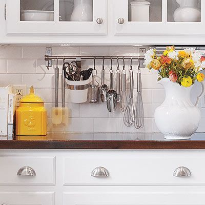 Put kitchen utensils within easy reach by hanging them from a modular utility rail mounted on the backsplash. IKEA and ClosetMaid both carry affordably priced selections. | Photo: Ryan Kurtz | thisoldhouse.com