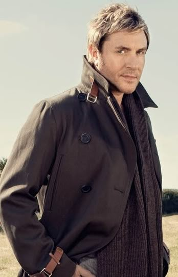 I LOVE the juxtaposition of fashion forward hair and a classic clothing piece. Simon in a classic trench with two toned hair and stubble. Stylish.