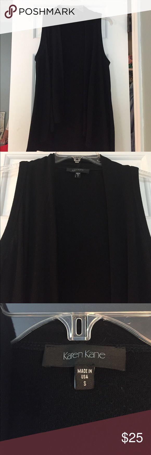 Karen Kane Sleeveless Black Vest Sleeveless vest, great length. 62% Polyester, 33% Rayon and 5% Spandex. Karen Kane Tops