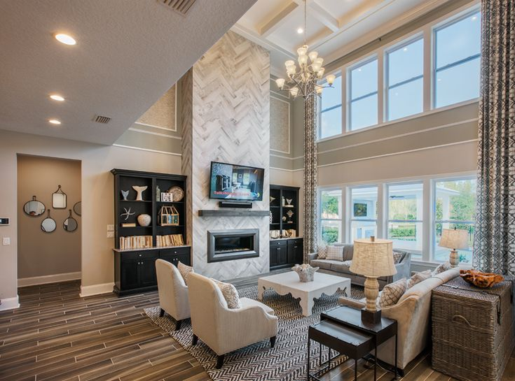We love the high ceilings in the Westbrook model by Toll Brothers! #nocatee #coastaloaks #livingroom