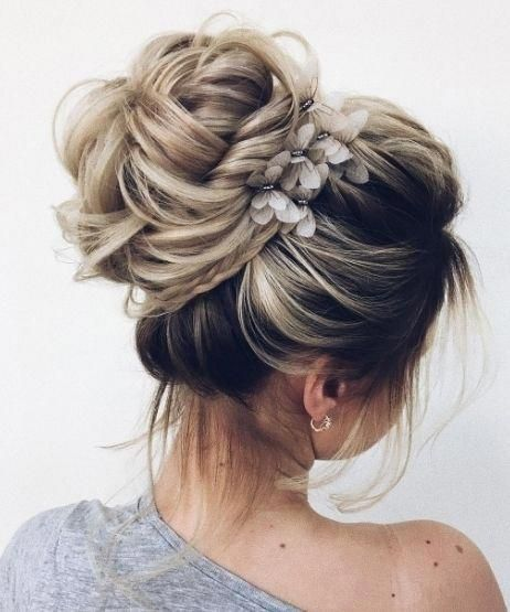 100+ Elegant wedding ideas to wow your guests---elegant and classy wedding hairstyles, highbun updo hair with floral decors, vintage weddings,