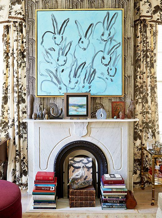 House Tour:Jane Scott Hodges - Design Chic- love the abstract bunny art in the living room and the stack of books is perfect