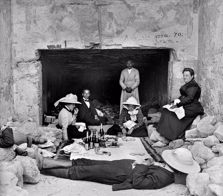 c.1898. Formally attired Victorian holidaymakers nap after having a wine-fuelled picnic inside a temple.