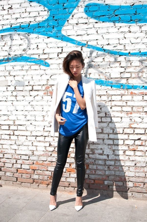 Super Bowl Style - How to Make a Sports Jersey Look Chic - over-the-shoulder white blazer, worn with a jersey + black leather pants and pointy white heels