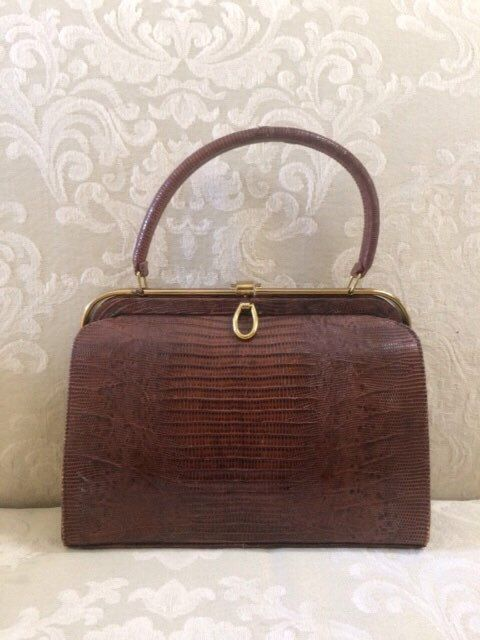 A personal favorite from my Etsy shop https://www.etsy.com/listing/482009422/vintage-kiss-lock-crocodile-handbag-top