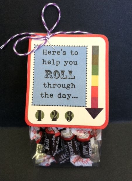 """20 mini Tootsie Rolls inside a cellophane bag with a tag that says: """"Here's to help you roll through the day..."""""""