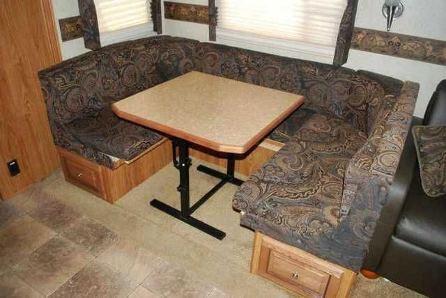 2013 Used Forest River Rockwood 8311SS Travel Trailer in Kentucky KY.Recreational Vehicle, rv, 2013 Forest River Rockwood 8311SS, You won't want to come home when you camp in this pre-owned Forest River Rockwood 8311SS. This 2013 model travel trailer has a rear bunkhouse, front bedroom and plenty of living space in between. The central living area has one slide with a dining booth and sofa. There's a front entertainment center and easy access to the kitchen, which is just across from the…