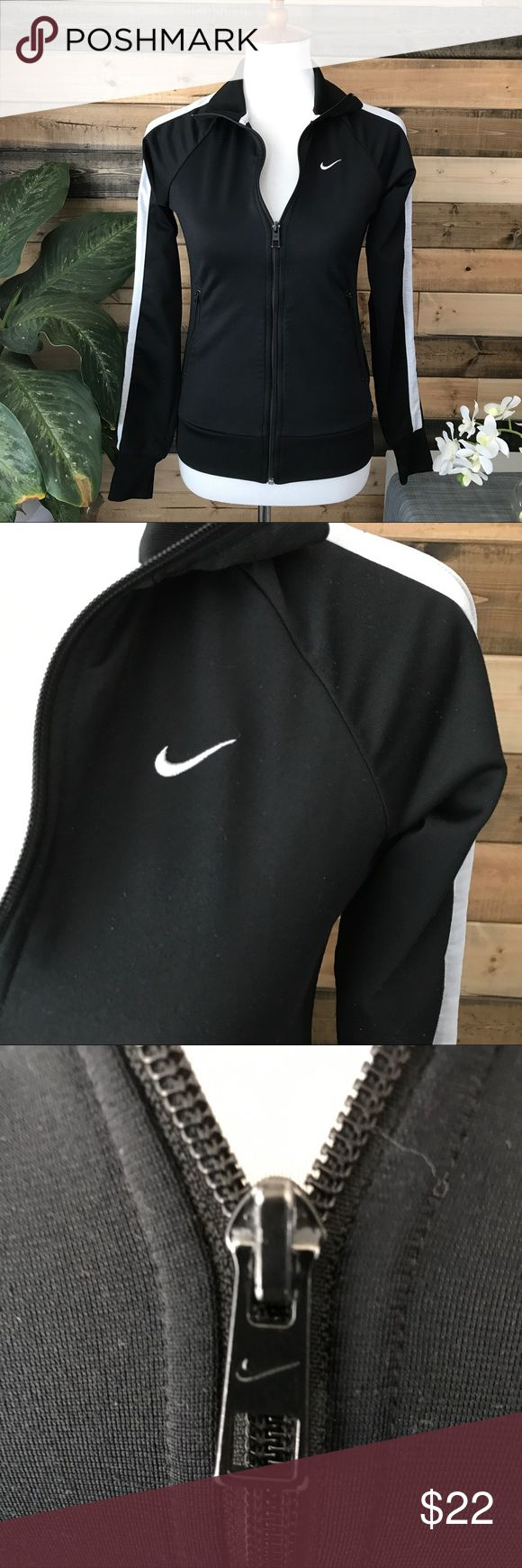 """Nike black & white zip up track jacket! Small Black and white track jacket by Nike! Black body with white stripes down sleeves. Zippered pockets on either side. Good condition. Bust 17"""" Length 24"""" Nike Jackets & Coats"""
