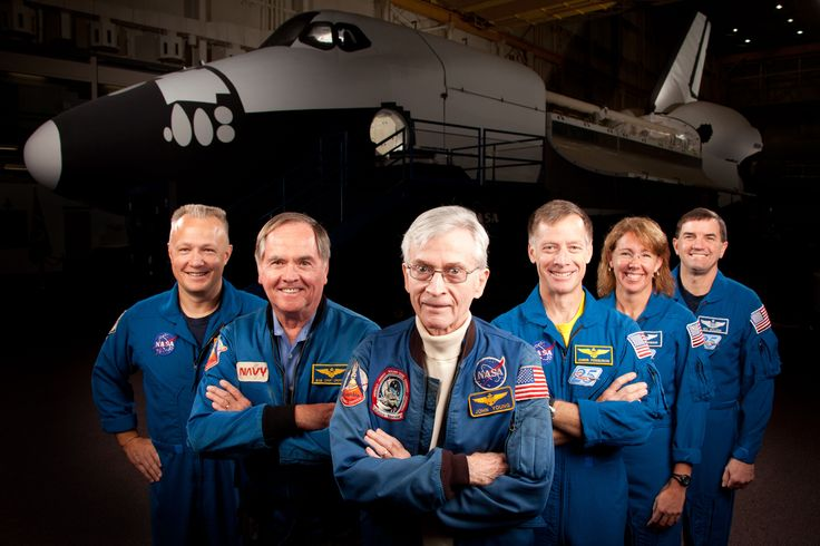 From left to right, they are: STS-135 pilot Doug Hurley, STS-1 pilot Robert Crippen, STS-1 commander John Young (a former Gemini and moonwalking Apollo astronaut), STS-135 commander Chris Ferguson, and STS-135 mission specialists Sandy Magnus and Rex Walheim.