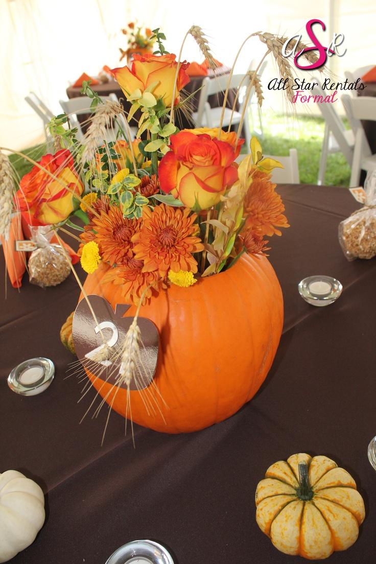 Festive fall pumpkin flower centerpiece wedding decor