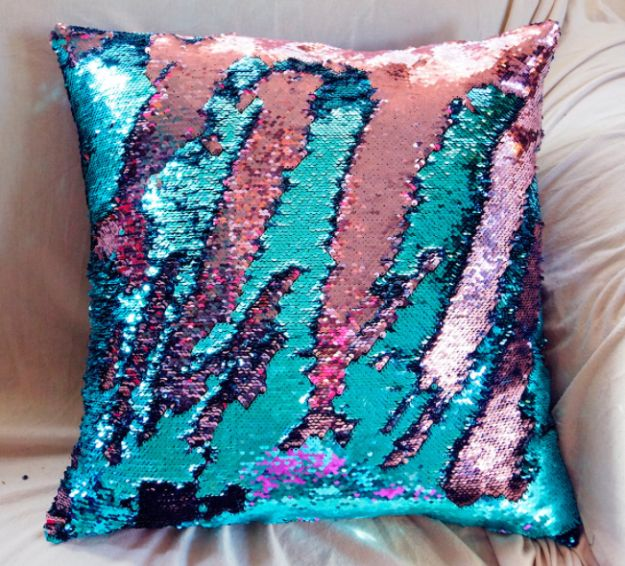 A color-changing sequin pillow that no merperson's house is complete without. | 18 Inexpensive Gifts For The Everyday Mermaid