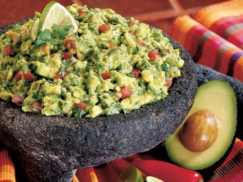 Guacamole  2-3 Large Avocados  1 Clove Garlic, peeled and minced  1/2 Cup Onion (preferably Red Onion) finely chopped  1/2 Cup Roma Tomato, seeds removed, finely chopped  1/2 Cup Cilantro, finely chopped  1 Habanero, Serrano or Jalapeño Chile Pepper, minced, optional (remove seeds to reduce spiciness)  Juice of 1 Lime  1 Tablespoon Cumin  Salt to Taste