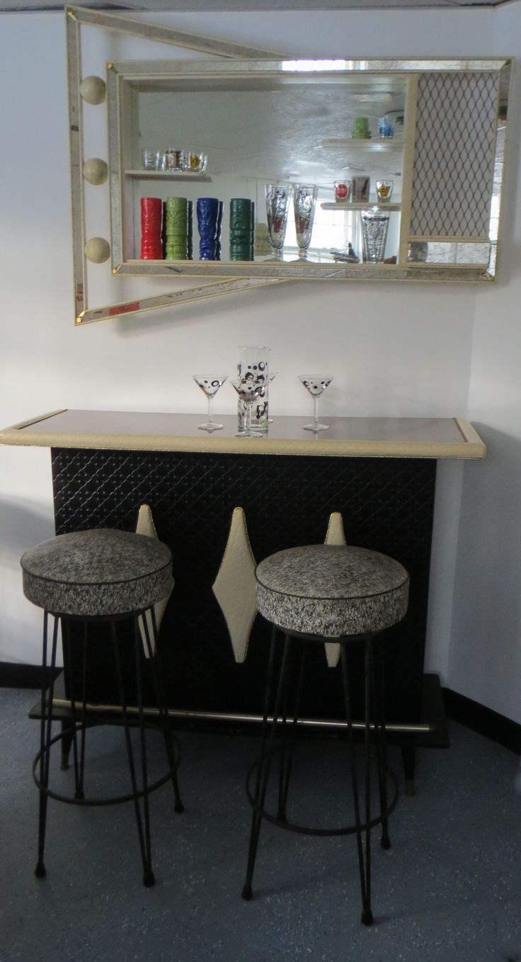 My bar, purchased at a local yard sale from the children of the original owner.  The glassware is a mix of vintage and new.  The barstools and shadowbox came from the Brimfield Antiques Show.